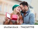 couple in love.man surprising... | Shutterstock . vector #746269798