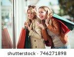 happy friends shopping. two... | Shutterstock . vector #746271898
