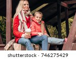 happy mother and daughter with... | Shutterstock . vector #746275429
