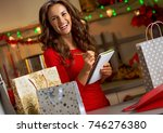 happy young woman checking list ...   Shutterstock . vector #746276380