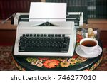 a typewriter  tea and a candle. ... | Shutterstock . vector #746277010