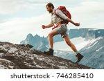 man adventurer skyrunning in... | Shutterstock . vector #746285410