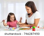 mother and daughter together... | Shutterstock . vector #746287450