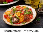 summer salad of tomatoes of... | Shutterstock . vector #746297086