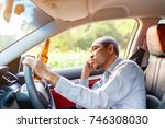 drunk asian young man drives a... | Shutterstock . vector #746308030