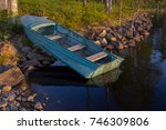 boat at the sunset near the... | Shutterstock . vector #746309806
