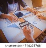 business people discuss...   Shutterstock . vector #746335768