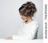 fashion studio portrait of... | Shutterstock . vector #746392060