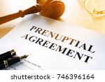 prenuptial agreement on a table. | Shutterstock . vector #746396164