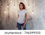 sexy woman in a white t shirt... | Shutterstock . vector #746399533