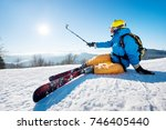 shot of a skier sitting on the... | Shutterstock . vector #746405440