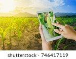 hand using tablet inspecting... | Shutterstock . vector #746417119