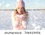 girl blowing on the snow in the ...   Shutterstock . vector #746419456