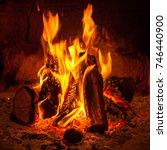 a fire burns in a fireplace ... | Shutterstock . vector #746440900