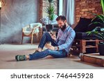 a man drinks coffee in a room... | Shutterstock . vector #746445928