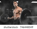 handsome man with big muscles ... | Shutterstock . vector #746448349