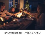 happy extended family toasting... | Shutterstock . vector #746467750