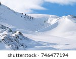Backcountry. A Group Of Skiers...
