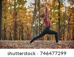 beautiful young woman practices ... | Shutterstock . vector #746477299