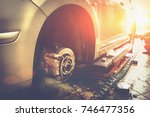 car in garage in auto mechanic... | Shutterstock . vector #746477356