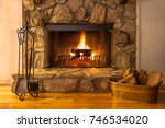 a warm fire in the stone... | Shutterstock . vector #746534020