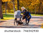a young mother with a stroller... | Shutterstock . vector #746542930