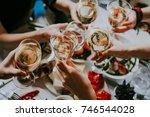 glasses of white wine seen... | Shutterstock . vector #746544028