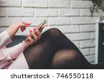 woman sitting at the wall and... | Shutterstock . vector #746550118