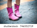 Pink Cowboy Boots On Gravel