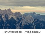 sunrise behind a mountain ridge. | Shutterstock . vector #746558080