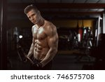 man sports in the gym.guy in... | Shutterstock . vector #746575708