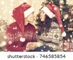 happy couple with xmas tree and ...   Shutterstock . vector #746585854