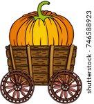 big pumpkin in wooden trolley   | Shutterstock .eps vector #746588923