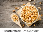 peanuts in a white cup rests on ... | Shutterstock . vector #746614909