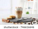 glass with latte macchiato on... | Shutterstock . vector #746616646