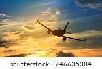 silhouette from a landing plane ... | Shutterstock . vector #746635384