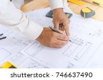 hands of engineer working on... | Shutterstock . vector #746637490