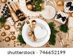 christmas table setting. gold... | Shutterstock . vector #746652199