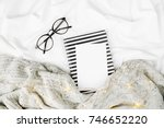 mockup card and planner on bed... | Shutterstock . vector #746652220