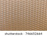 Small photo of Zooming closeup view of brownish overlapping wooden basket bottom uses as a background, texture, wallpaper or abstract