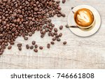 coffee cup and coffee beans on... | Shutterstock . vector #746661808
