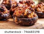 baked champignon caps stuffed... | Shutterstock . vector #746683198