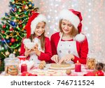 mother and daughter cooking... | Shutterstock . vector #746711524