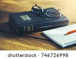 holy bible with eye glasses... | Shutterstock . vector #746726998