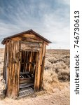 Old Wooden Outhouse In A Desert....