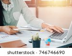 businessman working laptop... | Shutterstock . vector #746746690