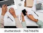 business team using laptop... | Shutterstock . vector #746746696