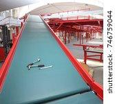 tools at conveyor belt loading... | Shutterstock . vector #746759044