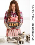 woman baking cookies in the... | Shutterstock . vector #746773798