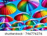 rainbow umbrella on sky... | Shutterstock . vector #746776276